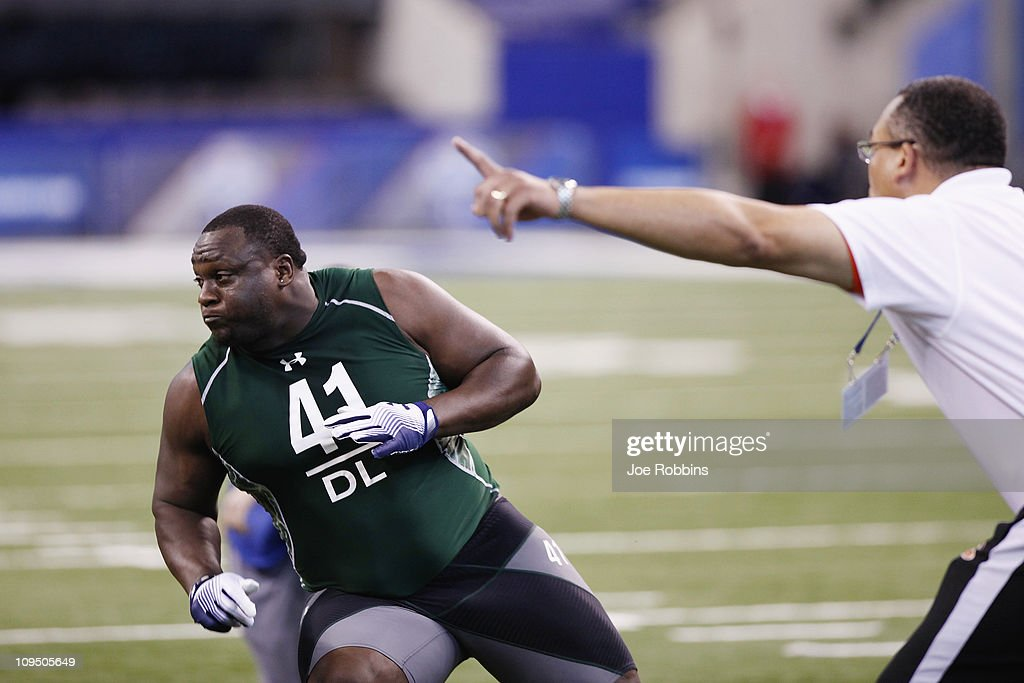 Defensive lineman Jerrell Powe of Mississippi runs through a drill during the 2011 NFL Scouting Combine at Lucas Oil Stadium on February 28, 2011 in Indianapolis, Indiana.