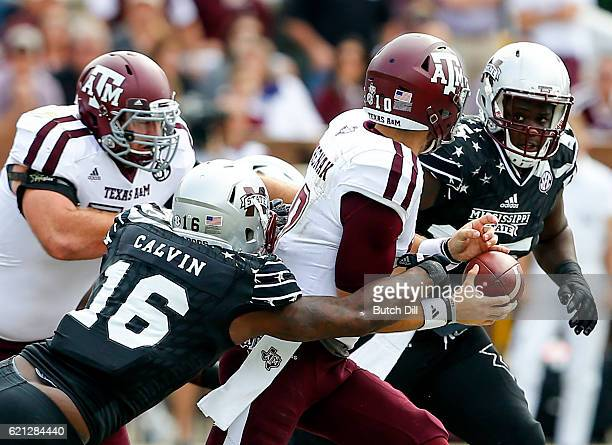Defensive lineman Johnathan Calvin of the Mississippi State Bulldogs strips the ball from quarterback Jake Hubenak of the Texas AM Aggies and the...