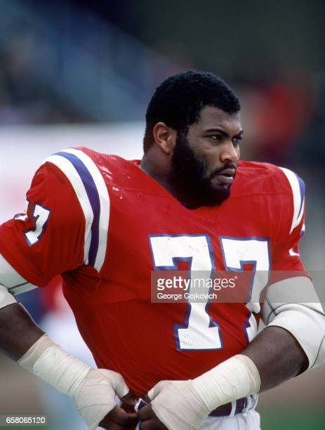 Defensive lineman Kenneth Sims of the New England Patriots looks on from the sideline during a game against the Cleveland Browns at Cleveland...
