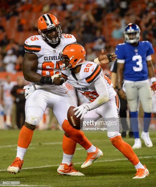 Defensive lineman Larry Ogunjobi and cornerback Briean BoddyCalhoun of the Cleveland Browns celebrate an interception by BoddyCalhoun in the the...