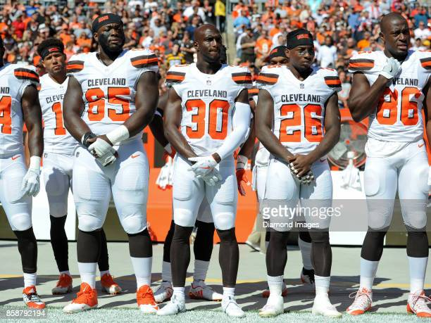 Defensive lineman Larry Ogunjobi cornerback Jason McCourty safety Derrick Kindred and tight end Randall Telfer of the Cleveland Browns stand on the...