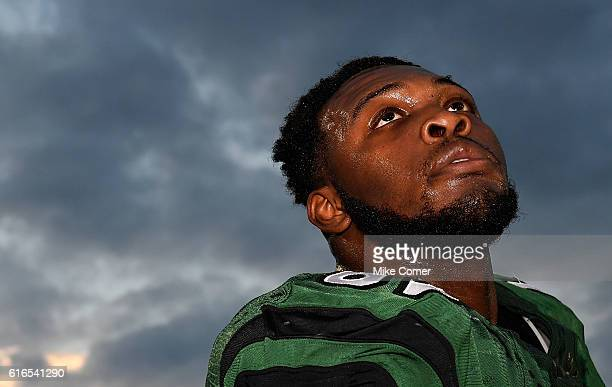 Defensive lineman Larry Ogunjobi of the Charlotte 49ers looks on during a game against the FIU Golden Panthers at Jerry Richardson Stadium on October...