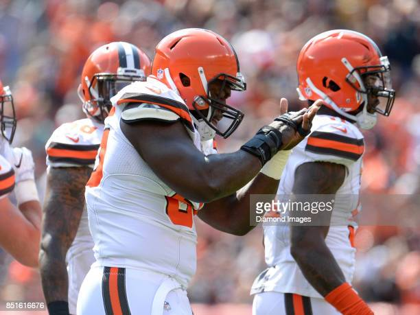 Defensive lineman Larry Ogunjobi of the Cleveland Browns applauds after tackling running back LeVeon Bell of the Pittsburgh Steelers for a loss in...