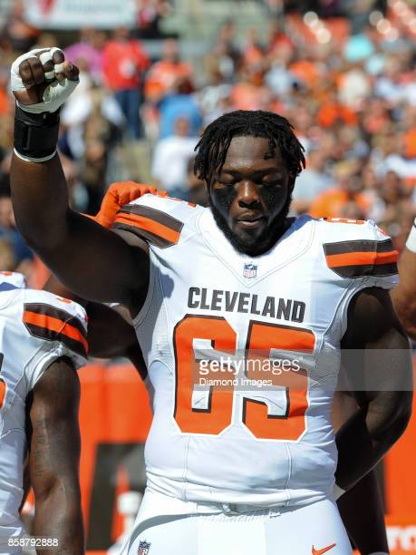 Defensive lineman Larry Ogunjobi of the Cleveland Browns raises his fist as he stands for the National Anthem prior to a game on October 1 2017...
