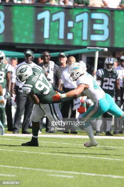 Defensive Lineman Lawrence Thomas of the New York Jets makes a catch against the Miami Dolphins on September 24 2017 at MetLife Stadium in East...