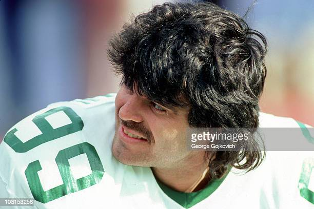 Defensive lineman Mark Gastineau of the New York Jets looks on from the sideline during a game against the Tampa Bay Buccaneers at Giants Stadium on...