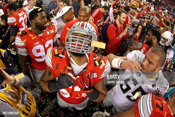 Defensive lineman Michael Bennett wearing a jersey in honor of fallen teammate Kosta Karageorge of the Ohio State Buckeyes celebrates after defeating...
