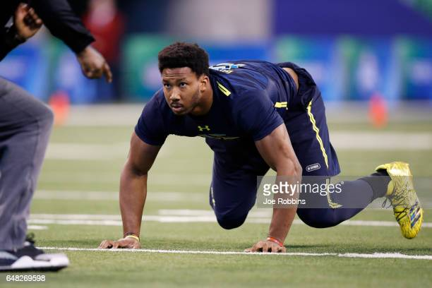 Defensive lineman Myles Garrett of Texas AM participates in a drill during day five of the NFL Combine at Lucas Oil Stadium on March 5 2017 in...
