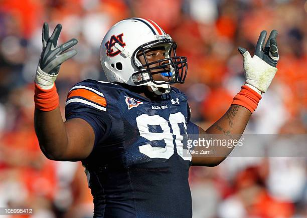 Defensive lineman Nick Fairley of the Auburn Tigers celebrates a play during the game against the Arkansas Razorbacks at JordanHare Stadium on...