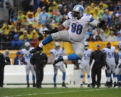 Defensive lineman Nick Fairley of the Detroit Lions jumps in the air to celebrate after sacking quarterback Ben Roethlisberger of the Pittsburgh...
