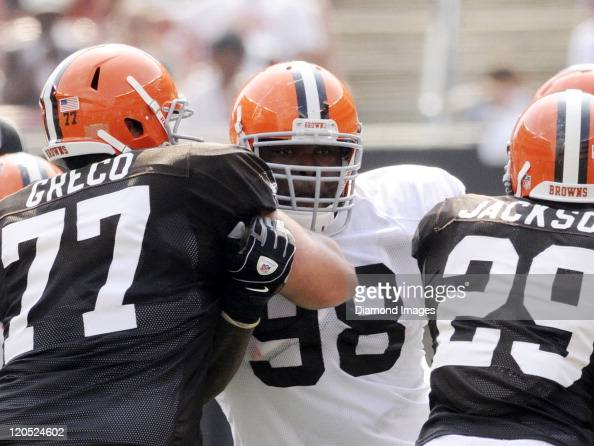 Defensive lineman Phil Taylor of the Cleveland Browns fights through the blocks of offensive lineman John Greco and running back Brandon Jackson...