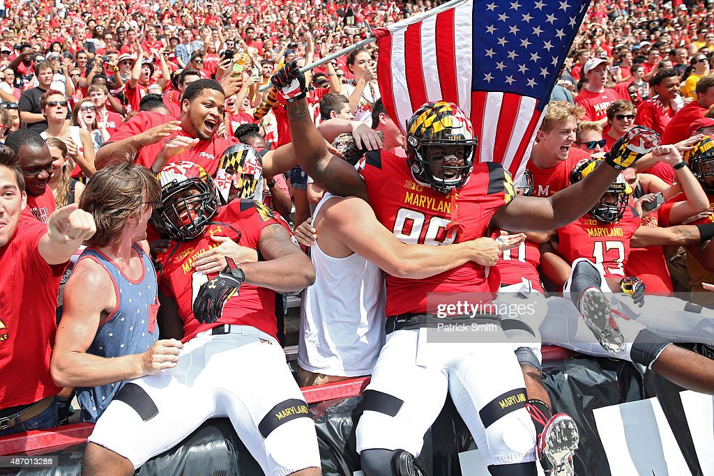 Defensive lineman Quinton Jefferson of the Maryland Terrapins and teammates jump into the crowd before playing the Richmond Spiders at Byrd Stadium...