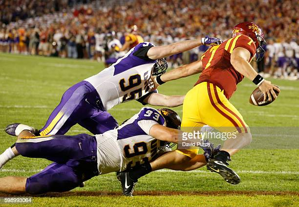 Defensive lineman Seth Thomas and defensive lineman Karter Schult of the Northern Iowa Panthers tackled quarterback Joel Lanning of the Iowa State...