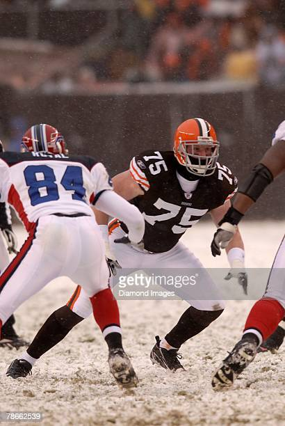 Defensive lineman Simon Fraser of the Cleveland Browns rushes the quarterback as tight end Robert Royal of the Buffalo Bills prepares to block Fraser...