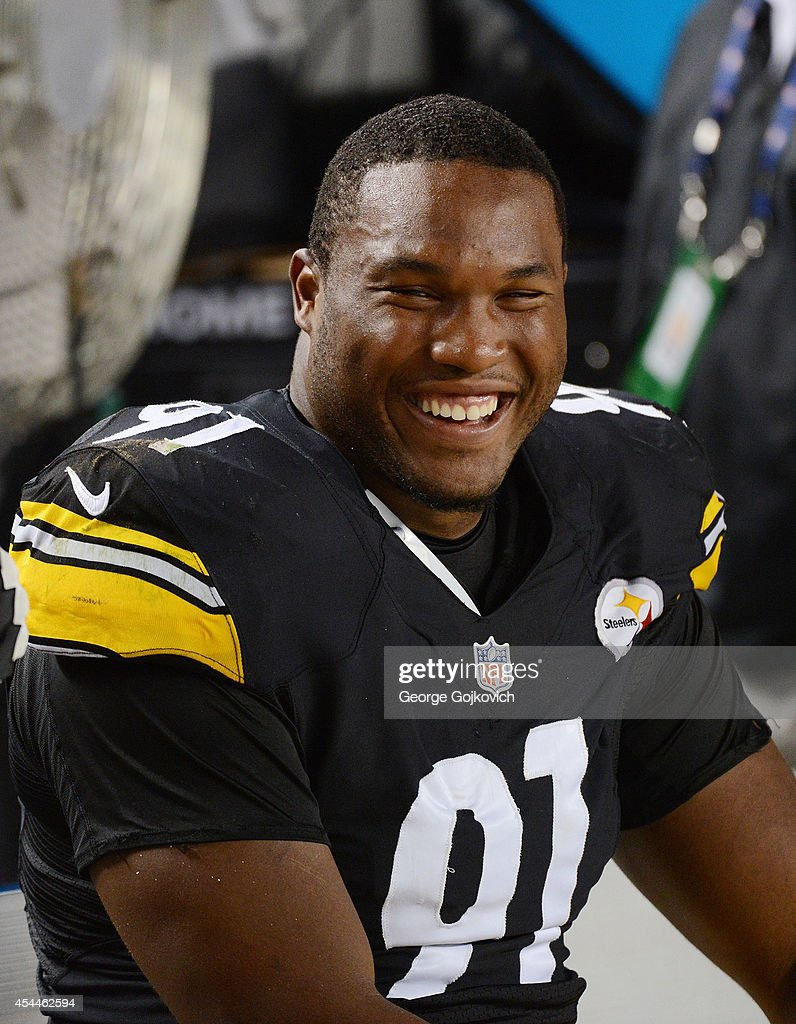 Defensive lineman <a gi-track='captionPersonalityLinkClicked' href=/galleries/search?phrase=Stephon+Tuitt&family=editorial&specificpeople=8563449 ng-click='$event.stopPropagation()'>Stephon Tuitt</a> #91 of the Pittsburgh Steelers smiles as he looks on from the sideline during a preseason game against the Carolina Panthers at Heinz Field on August 28, 2014 in Pittsburgh, Pennsylvania. The Panthers defeated the Steelers 10-0.