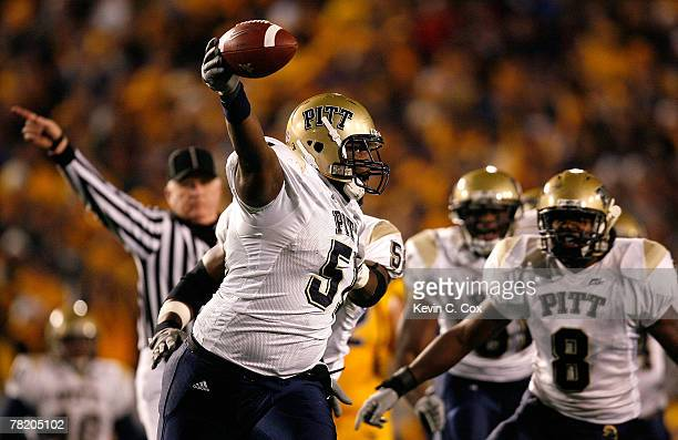 Defensive lineman Tommie Duhart of the Pittsburgh Panthers celebrates after recovering a fumble by backup quarterback Jarrett Brown of the West...