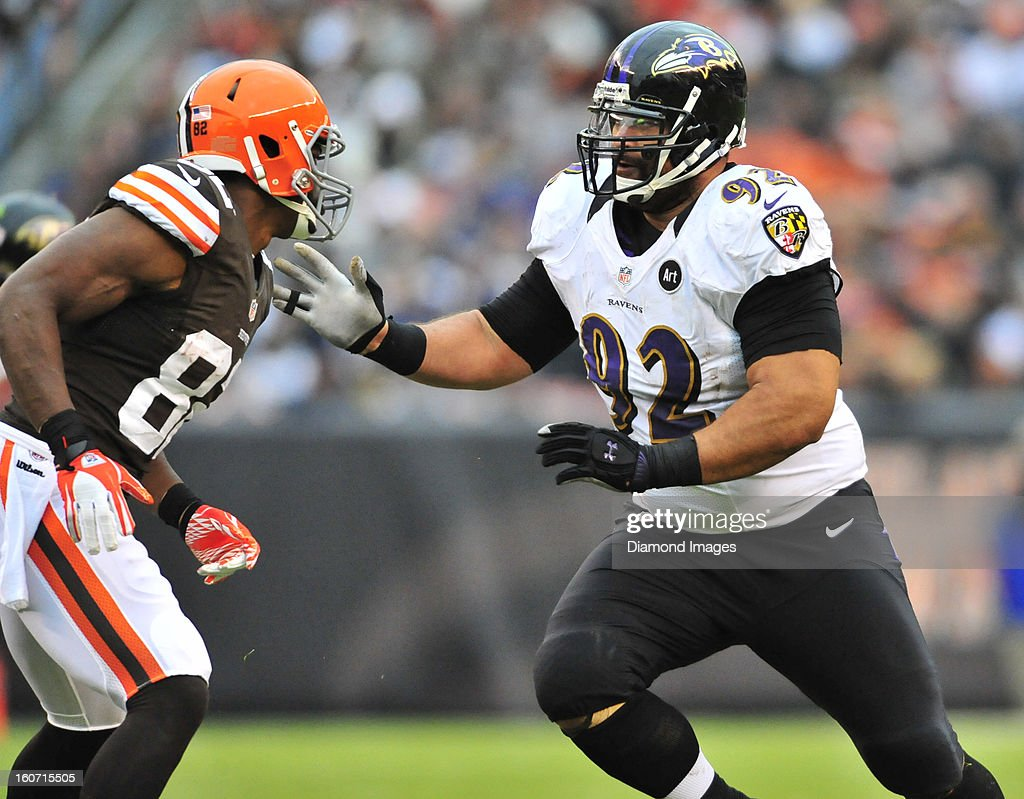 Defensive linemen Haloti Ngata #92 of the Baltimore Ravens puts a pass rush move on tight end Benjamin Watson #82 of the Cleveland Browns during a game against the Cleveland Browns at Cleveland Browns Stadium in Cleveland, Ohio. The Ravens won 25-15.