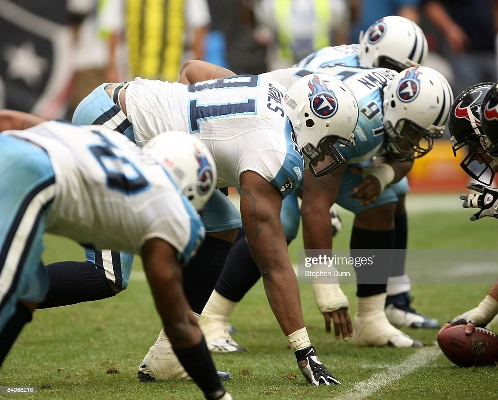 Defensive linemen Jason Jones #91 and Tony Brown #97 of the Tennessee Titans set on the line of scrimmage against the Houston Texans on December 14, 2008 at Reliant Stadium in Houston, Texas.