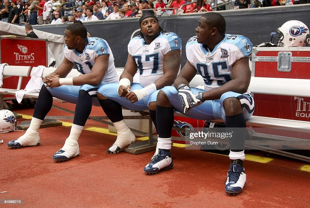 Defensive linemen Jason Jones #91, Tony Brown #97 and William Hayes #95 of the Tennessee Titans sit on the bench before the game against the Houston Texans on December 14, 2008 at Reliant Stadium in Houston, Texas.