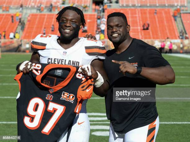 Defensive linemen Larry Ogunjobi of the Cleveland Browns and Geno Atkins of the Cincinnati Bengals pose for a picture after a game on October 1 2017...
