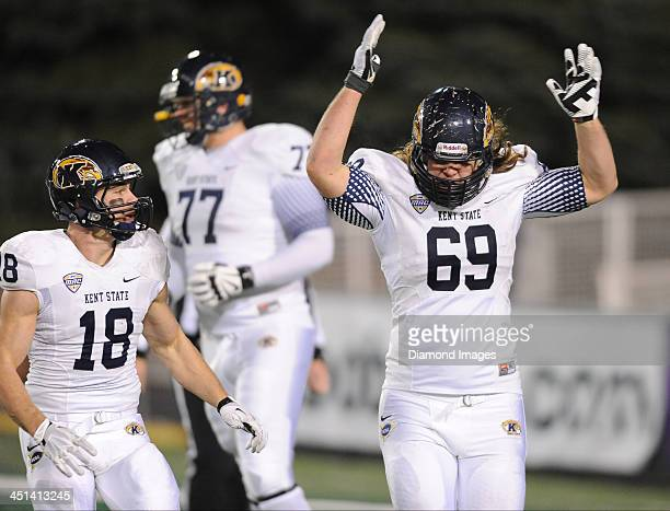 Defensive linemen Nate Terhune of the Kent State Golden Flashes celebrates after scoring a touchdown on a fake punt during a game against the Ohio...