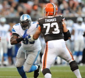 Defensive linemen Nick Fairley of the Detroit Lions rushes the quarterback while being blocked by offensive linemen Joe Thomas of the Cleveland...