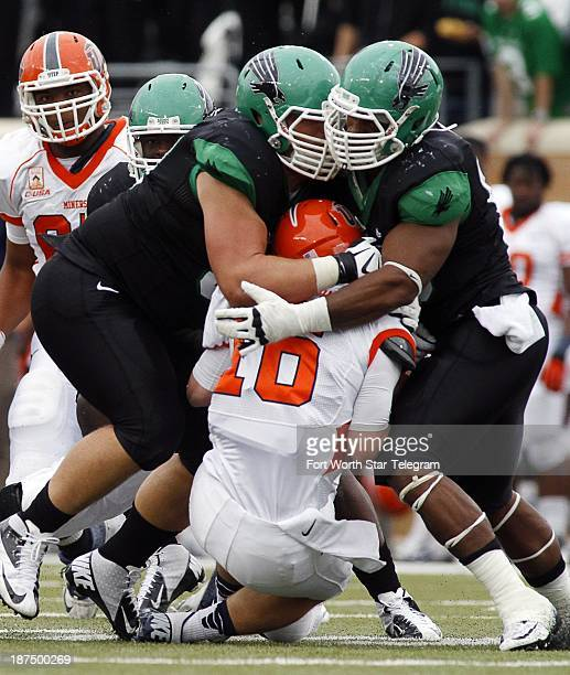 Defensive linemen Richard Abbe and Brandon McCoy of North Texas sack quarterback Mack Leftwich of UTEP at Apogee Stadium in Denton Texas on Saturday...