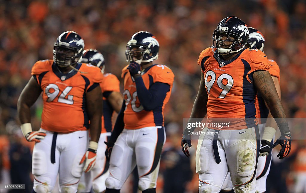 Defensive linemen <a gi-track='captionPersonalityLinkClicked' href=/galleries/search?phrase=Terrance+Knighton&family=editorial&specificpeople=5732536 ng-click='$event.stopPropagation()'>Terrance Knighton</a> #94, <a gi-track='captionPersonalityLinkClicked' href=/galleries/search?phrase=Shaun+Phillips&family=editorial&specificpeople=583097 ng-click='$event.stopPropagation()'>Shaun Phillips</a> #90 and <a gi-track='captionPersonalityLinkClicked' href=/galleries/search?phrase=Kevin+Vickerson&family=editorial&specificpeople=965648 ng-click='$event.stopPropagation()'>Kevin Vickerson</a> #99 of the Denver Broncos prepare to face the Oakland Raiders at Sports Authority Field at Mile High on September 23, 2013 in Denver, Colorado.