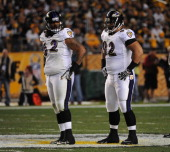 Defensive linemen Terrence Cody and Haloti Ngata of the Baltimore Ravens look on from the line of scrimmage during a game against the Pittsburgh...