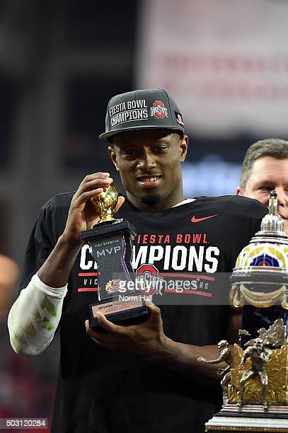 Defensive player of the game Eli Apple of the Ohio State Buckeyes holds the MVP trophy after the BattleFrog Fiesta Bowl at the University of Phoenix...