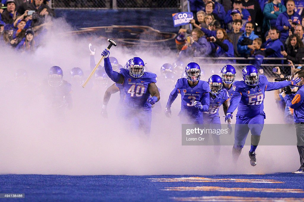 Defensive tackle Armand Nance of the Boise State Broncos carries the hammer and leads the Boise State Broncos out to start the game against the...