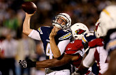 Defensive tackle Bruce Gaston of the Arizona Cardinals hits quarterback Brad Sorensen of the San Diego Chargers to force an incomplete pass at...
