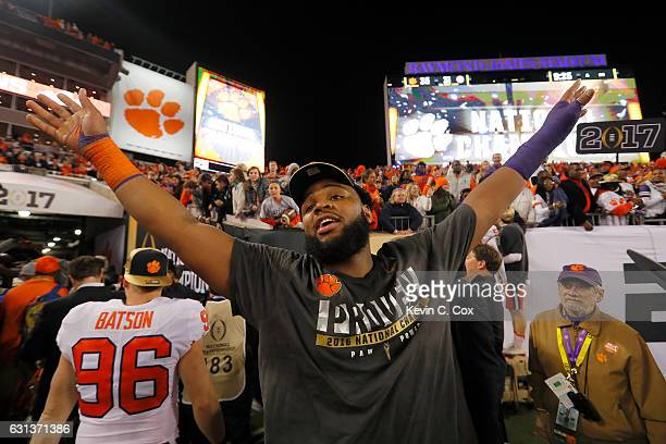Defensive tackle Carlos Watkins of the Clemson Tigers celebrates after defeating the Alabama Crimson Tide 3531 to win the 2017 College Football...