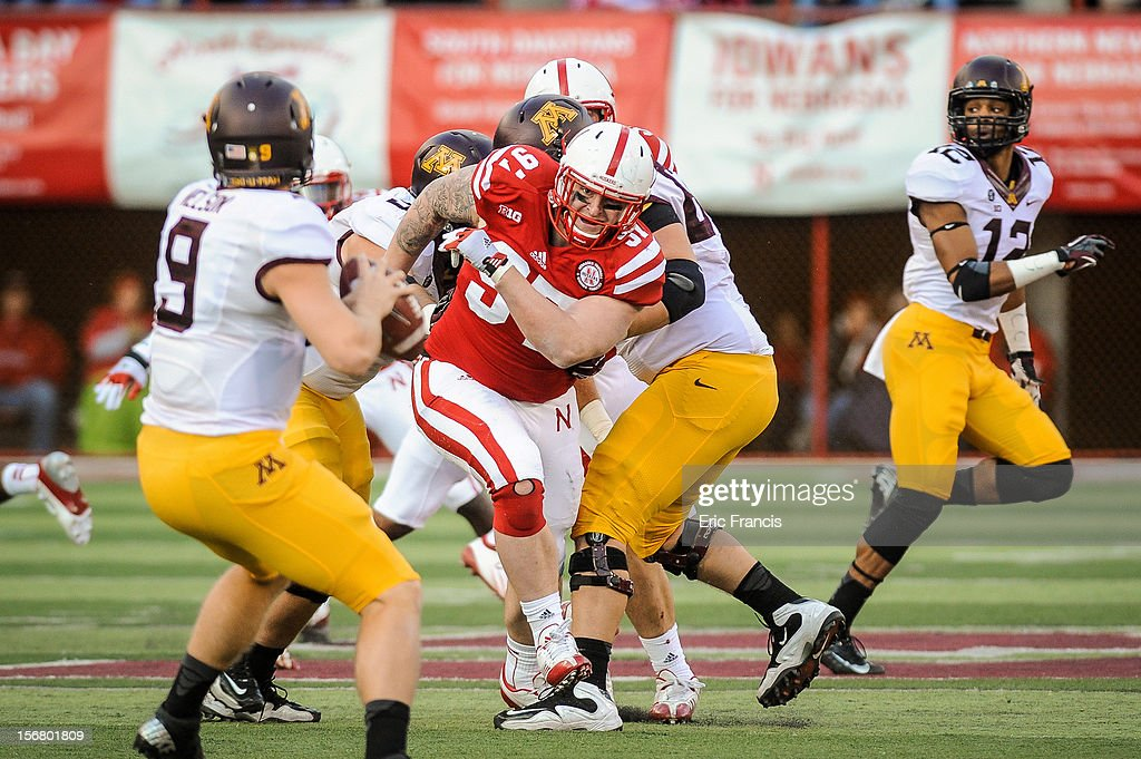 Defensive tackle Chase Rome #97 of the Nebraska Cornhuskers fights his way to try and reach quarterback Philip Nelson #9 of the Minnesota Golden Gophers during their game at Memorial Stadium on November 17, 2012 in Lincoln, Nebraska.