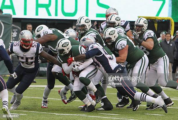 Defensive Tackle Chris Jones of the New England Patriots makes a stop against the New York Jets at MetLife Stadium on December 21 2014 in East...