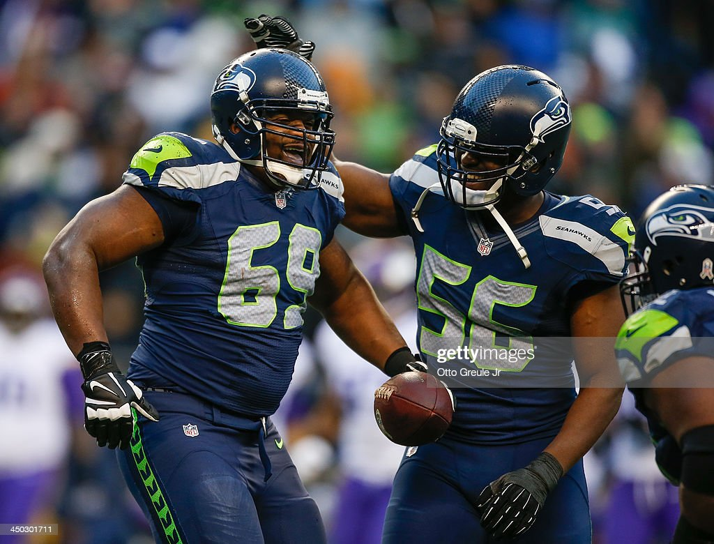 Defensive tackle Clinton McDonald #69 (L) of the Seattle Seahawks is congratulated by defensive end <a gi-track='captionPersonalityLinkClicked' href=/galleries/search?phrase=Cliff+Avril&family=editorial&specificpeople=2237705 ng-click='$event.stopPropagation()'>Cliff Avril</a> #56 after making an interception against the Minnesota Vikings at CenturyLink Field on November 17, 2013 in Seattle, Washington. The Seahawks defeated the Vikings 41-20.