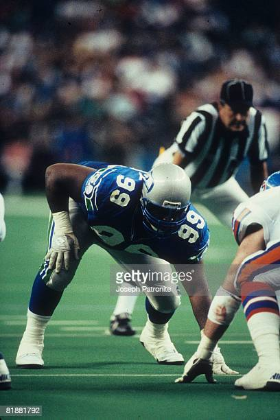 Defensive tackle Cortez Kennedy of the Seattle Seahawks lines up in a threepoint stance against the Denver Broncos at the Kingdome in Seattle...