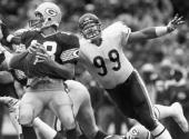 Defensive tackle Dan Hampton of the Chicago Bears closes in on quarterback Jim Zorn of the Green Bay Packers for a sack during a game at Lambeau...