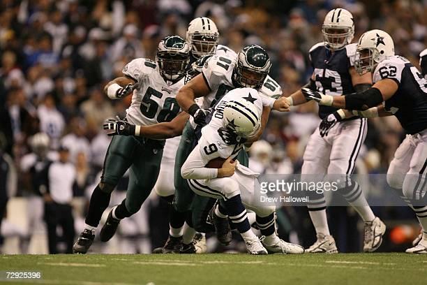 Defensive tackle Darwin Walker of the Philadelphia Eagles sacks quarterback Tony Romo of the Dallas Cowboys on December 25 2006 at Texas Stadium in...