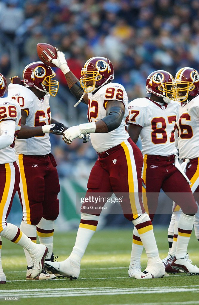 Defensive Tackle Daryl Gardener #92 Of The Washington Redskins Greets The  Offensive Line After Recovering