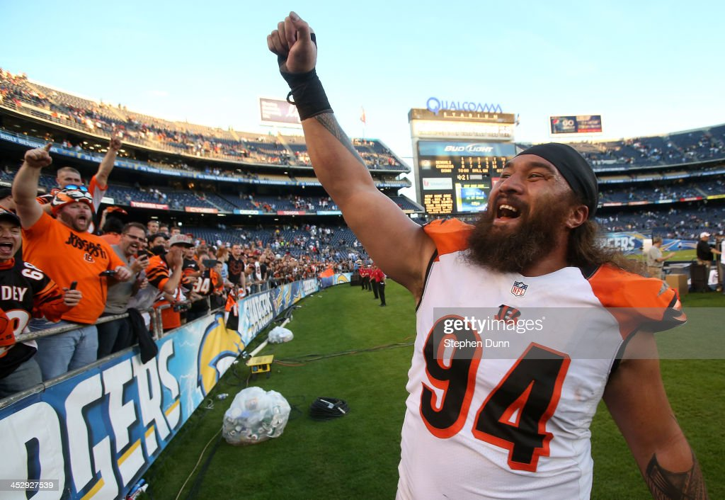 Defensive tackle Domata Peko of the Cincinnati Bengals celebrates with fans after the game with the San Diego Chargers at Qualcomm Stadium on...
