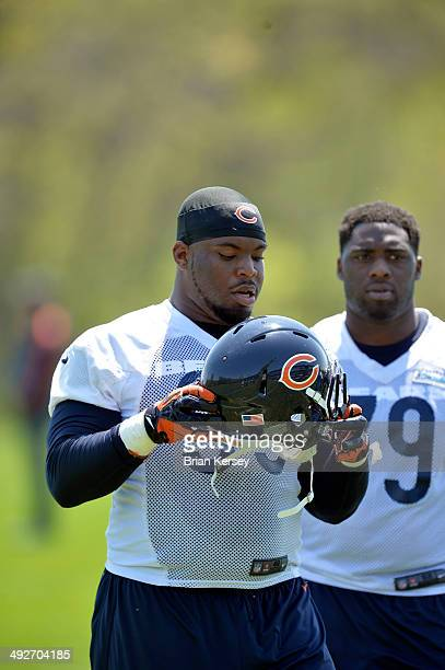 Defensive tackle Ego Ferguson of the Chicago Bears walks off the field after rookie minicamp at Halas Hall on May 18 2014 in Lake Forest Illinois
