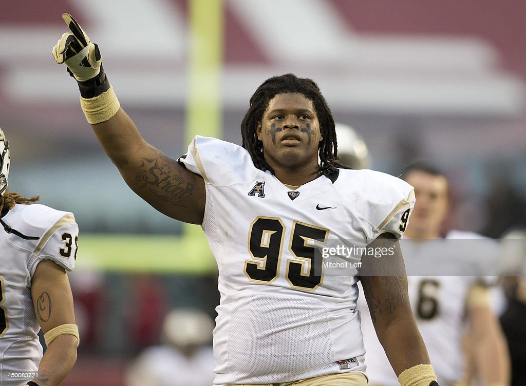Defensive tackle E.J. Dunston #95 of the University of Central Florida Knights celebrates their win against the Temple University Owls on November 16, 2013 at Lincoln Financial Field in Philadelphia, Pennsylvania.