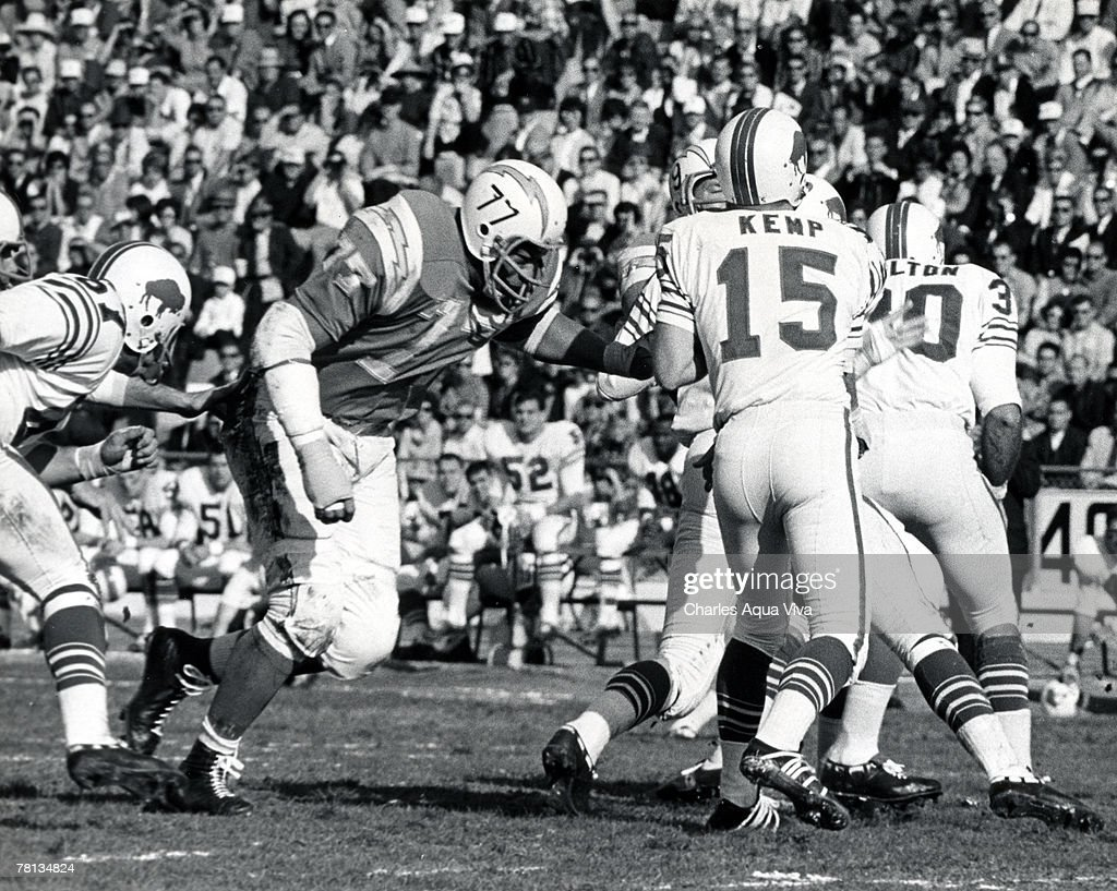 Defensive tackle Ernie Ladd of the San Diego Chargers pressures Buffalo quarterback Jack Kemp in a 230 loss to the Bills in the 1965 AFL Championship...