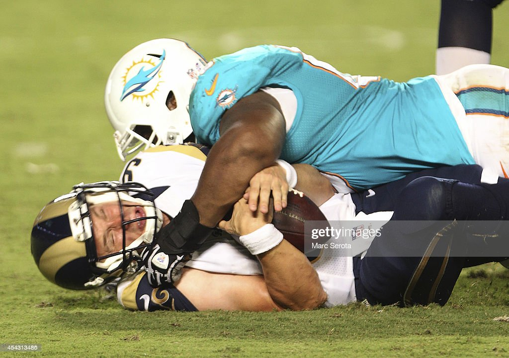 Defensive tackle Garrison Smith #68, right, sacks quarterback <a gi-track='captionPersonalityLinkClicked' href=/galleries/search?phrase=Austin+Davis&family=editorial&specificpeople=1058943 ng-click='$event.stopPropagation()'>Austin Davis</a> #9 of the St. Louis Rams in the second quarter of play at Sun Life Stadium on August 28, 2014 in Miami Gardens, Florida.
