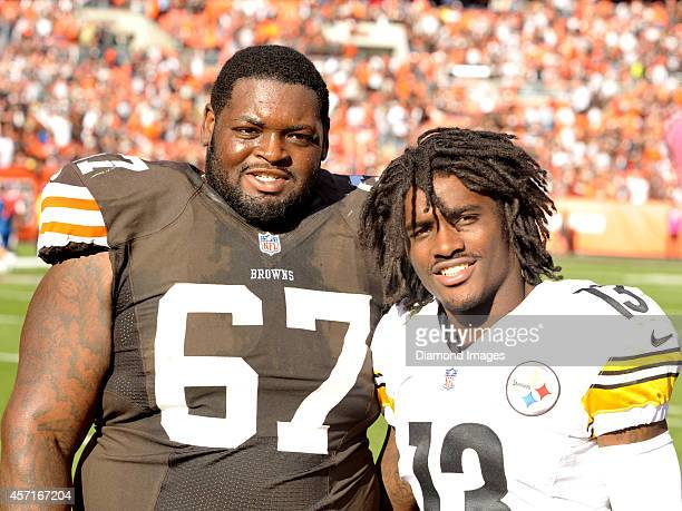 Defensive tackle Ishmaa'ily Kitchen of the Cleveland Browns and specialist Dri Archer of the Pittsburgh Steelers pose for a picture after a game...