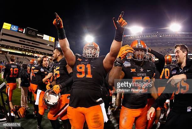 Defensive tackle James Castleman of the Oklahoma State Cowboys celebrates on the sidelines during the final moments of the TicketCity Cactus Bowl...