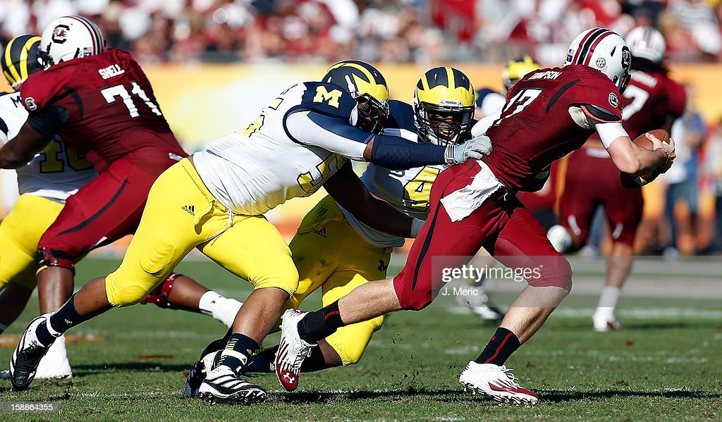Defensive tackle Jibreel Black #55 of the Michigan Wolverines sacks quarterback Dylan Thompson #17 of the South Carolina Gamecocks during the Outback Bowl Game at Raymond James Stadium on January 1, 2013 in Tampa, Florida.