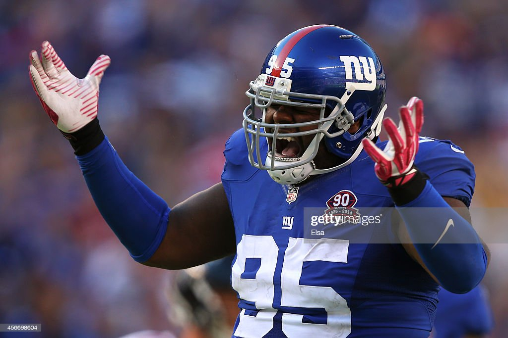 Defensive tackle Johnathan Hankins #95 of the New York Giants celebrates after sacking quarterback Matt Ryan #2 of the Atlanta Falcons in the fourth quarter of their game at MetLife Stadium on October 5, 2014 in East Rutherford, New Jersey.