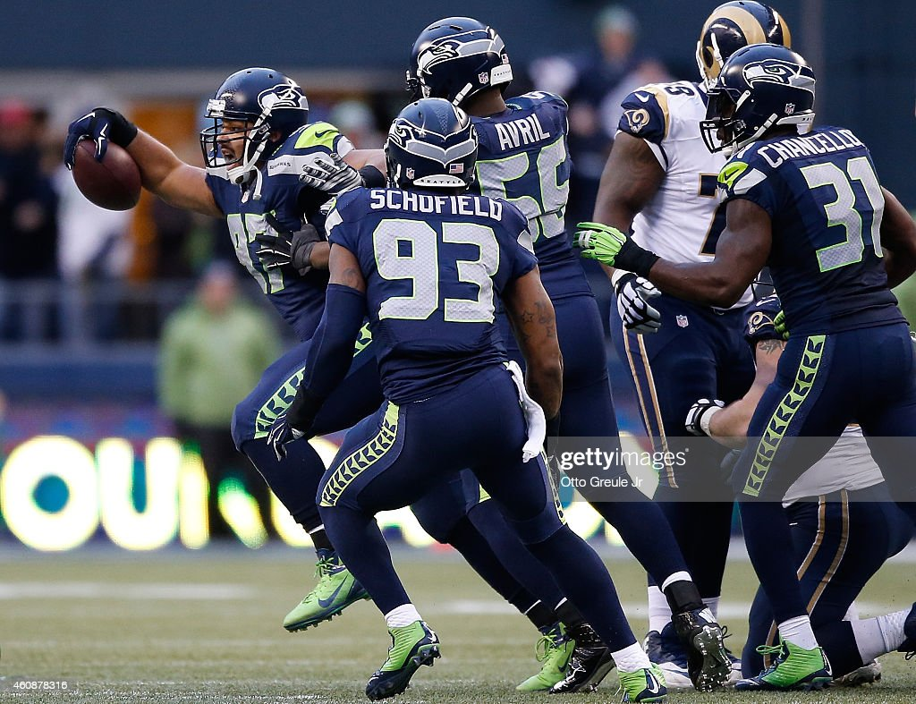 Defensive tackle <a gi-track='captionPersonalityLinkClicked' href=/galleries/search?phrase=Jordan+Hill+-+American+Football+Player&family=editorial&specificpeople=13503545 ng-click='$event.stopPropagation()'>Jordan Hill</a> #97 of the Seattle Seahawks celebrates with teammates after making an interception during the third quarter of the game against the St. Louis Rams at CenturyLink Field on December 28, 2014 in Seattle, Washington.